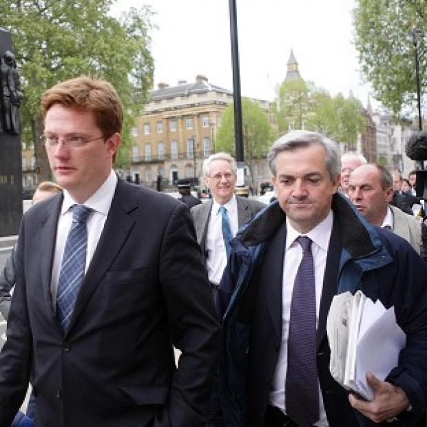 Liberal Democrats Chris Huhne (right) and Danny Alexander at the Cabinet Office as negotiations with the Conservatives continue