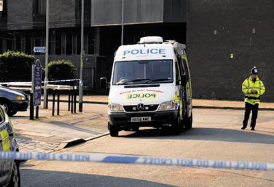 Police following an attack near Guildhall Walk in Portsmouth