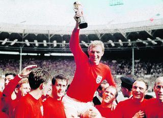 Daily Echo: Bobby Moore is carried by team members including Geoff Hurst, left