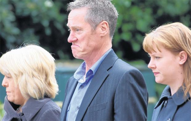 Roger Kearney arriving at Winchester Crown Court with partner Carol Goddard, left, and daughter Louisa Wiggington.