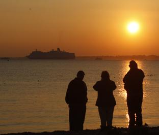 Watching from Hill Head as Queen Elizabeth sails off into the sunset