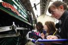 Sophie Fulton and Pippa Hill, both aged ten, sketch the locomotive Cheltenham.