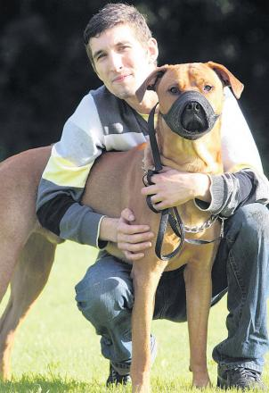 Aaron Clifford with his dog Reggie. The animal faces being put to sleep after biting a girl at the Haywain pub
