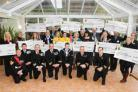 Smiles all round as HMS Collingwood hand out cash to charities