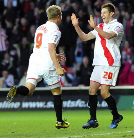 Adam Lallana, right, celebrates with Lee Barnard against Blackpool.