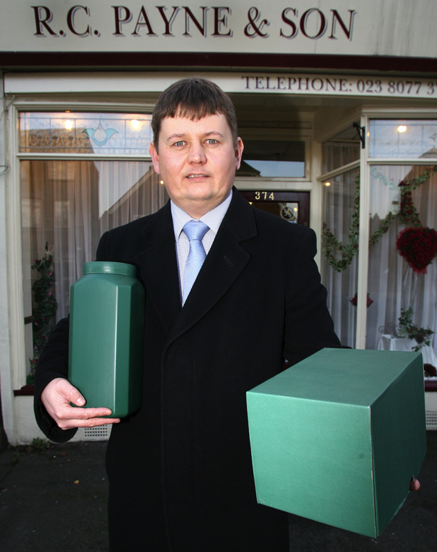 Funeral director Matthew Allen with the 'eco-urn', left, and the more traditional plastic type