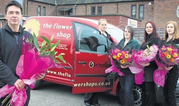 Daily Echo: Proprietor of The Flower Shop in Eastleigh High Street Lee Ackerman with one of his vans and employees, left to right, Natasha Barker, Abi Jurd, Shelley Read and Caroline Henley.