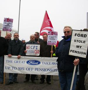 ANGRY: Retired Ford workers protest at the motor giant's headquarters in Essex.