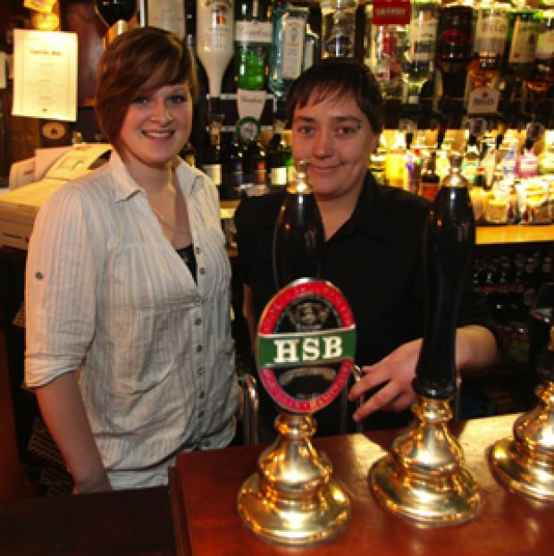 Daily Echo: Laura Inkpen and Nicola Colven behind the bar.