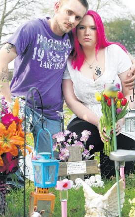 Grieving parents William Elkins and Cassandra Marshall who were poorly treated at the cemetery.