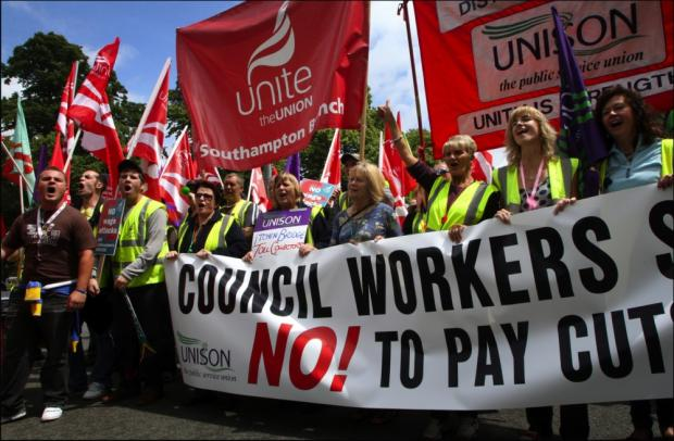 Council workers march against the pay cuts