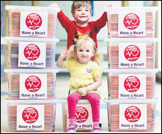 Toby Nash and Nancy Laverty, patients at Southampton hospital's children's cardiac E1 unit, with the 225,000 signature strong petition in the Daily Echo's Have a Heart Campaign.