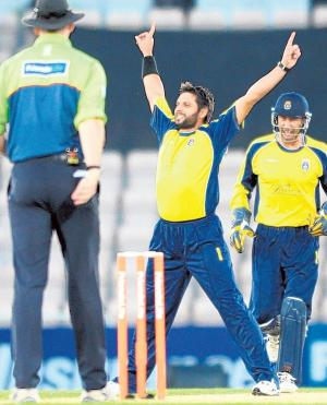 Shahid Afridi, above, takes his second wicket in his first over