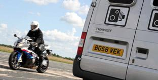 Daily Echo: A biker rides past the new speed camera van