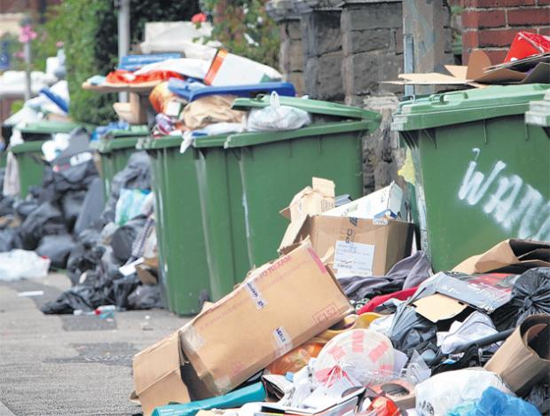 STRIKES: Overflowing bins in Southampton last summer