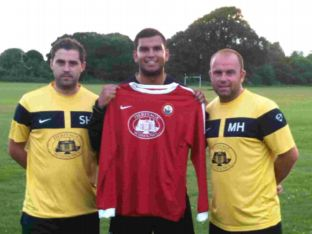 Pete Castle, centre, signs for Lymington during the summer watched by bosses Stuart, left, and Matt Hussey.