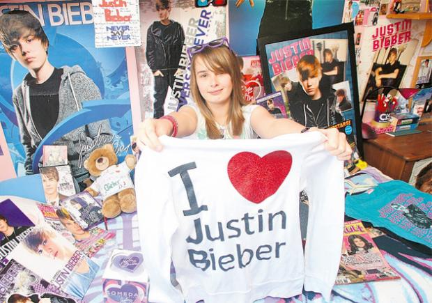 Justin Bieber fan Holly Sennett, 13, shows off some of her memorabilia collection