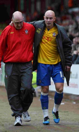 Richard Chaplow hobbles off the pitch at Ashton Gate