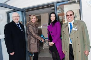 Caroline Dinenage MP cutting the ribbon with Steve Griffin, Laleh Yeganegy and Massoud Yeganegy