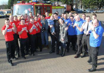 The police and firefighters who are taking part in a charity boxing match