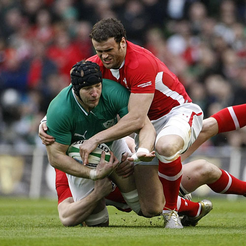 Ireland's Stephen Ferris gets tackled by Wales' Adam Rhys Jones (left) and Jamie Roberts (right)
