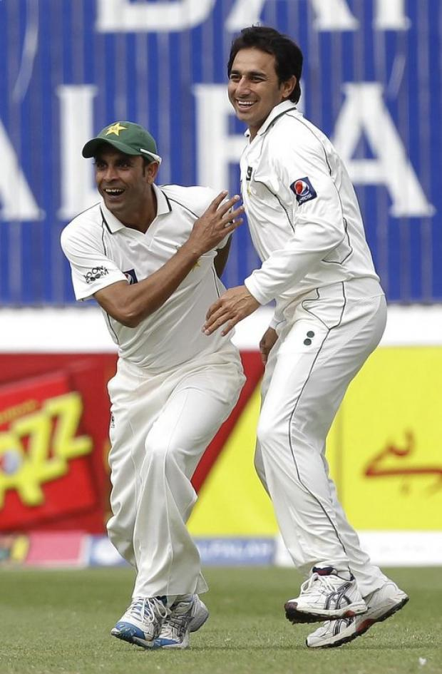 Saeed Ajmal, right, celebrates a wicket against England