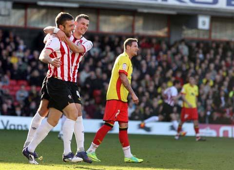 Lambert treble fires Saints back to top spot