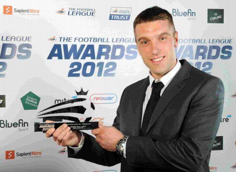 Rickie Lambert shows off his trophy