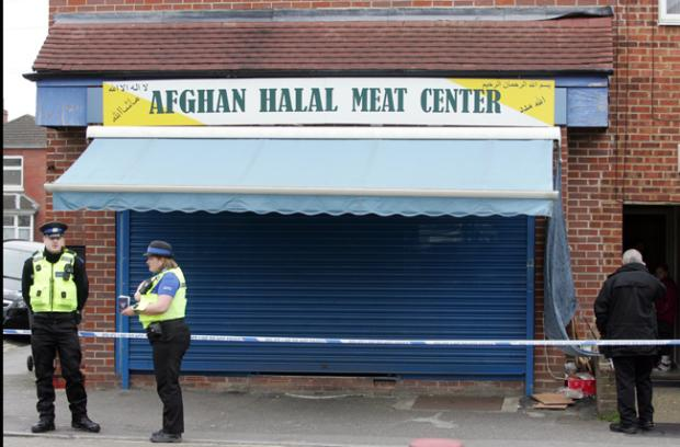 Police at the scene of the attack in Derby Road