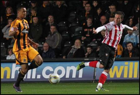 Pictures from the npower Championship match between Hull City and Saints. The unauthorised downloading, copying, editing or distribution of this picture is strictly prohibited.