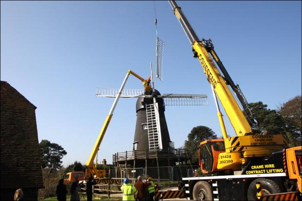 The sails of Bursledon Windmill are removed by crane
