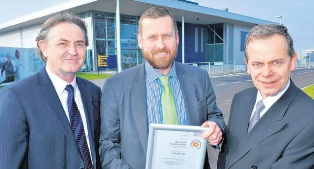 Bournemouth Airport's Ray Coggins and Mike Twomey receive the certificate from Graham Walford of SGS UK Ltd