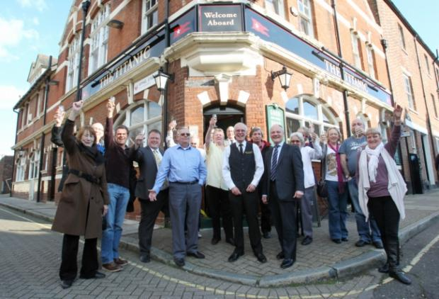 RELAUNCH: Martin Geer with Cllr Royston Smith and customers outside the pub
