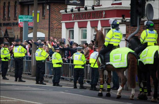 Daily Echo: Police dealing with football fans in Hampshire