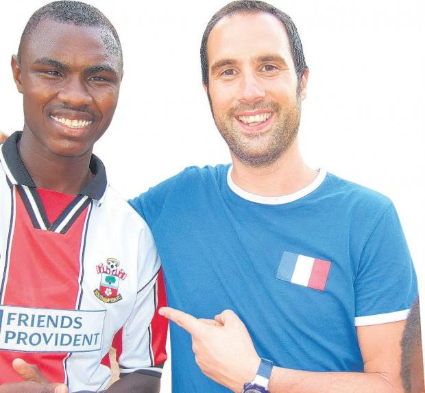 Saints supporter Hassan with Marcus.