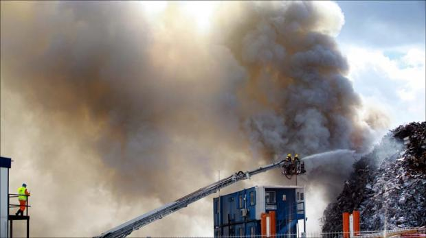 Firefighters tackle large blaze at docks