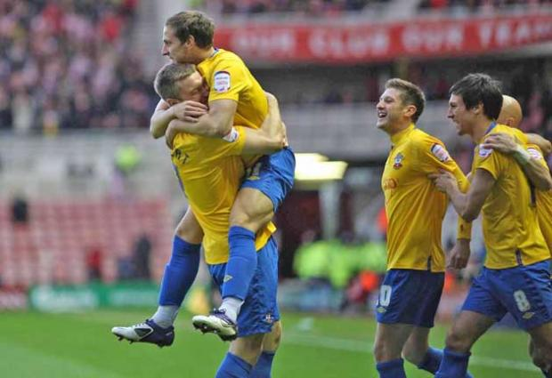 Adam Lallana and team mates celebrate Billy Sharp's opener in Saturday