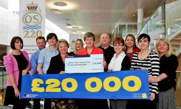 Ordnance Survey staff present their cheque to Marie Curie Cancer Care.