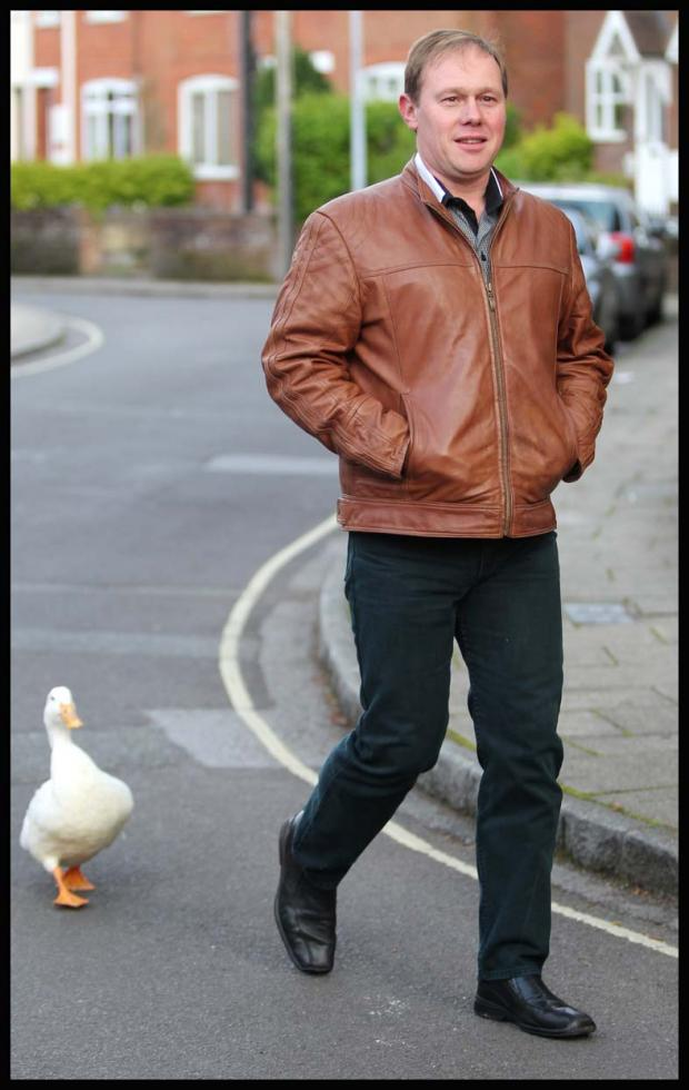 Wayne O'Donnell taking his duck Boris for a walk