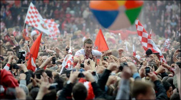 Rickie Lambert is chaired off the pitch by fans.