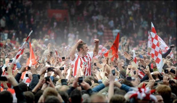 Rickie Lambert is held aloft by the Saints fans following promotion to the Premier League