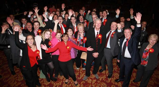 Labour activists celebrate their election win