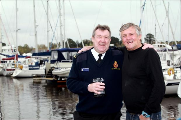 RESCUE: Lymington coastguard Steve Calfe, left, with the award he received for saving friend Jeff Evans, right