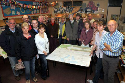Local residents and councillors look at amended plans put forward by Tesco