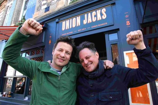 Jamie Oliver, left, at the opening of Union Jacks in Winchester in 2012, with business partner Chris Bianco
