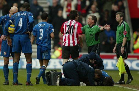 Referee Alan Whiley attempts to stop David Prutton confronting his assistant during Saints' home match against Arsenal in 2005