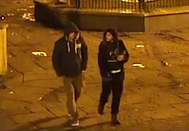 A CCTV image of two people police want to speak to.