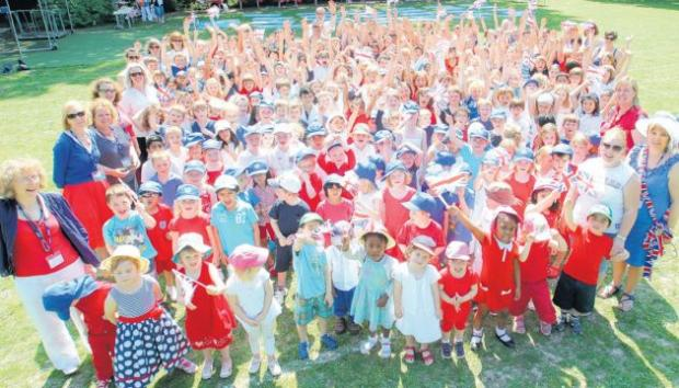 Sherborne House School children and staff celebrate the Jubilee with a red, white and blue playground party.