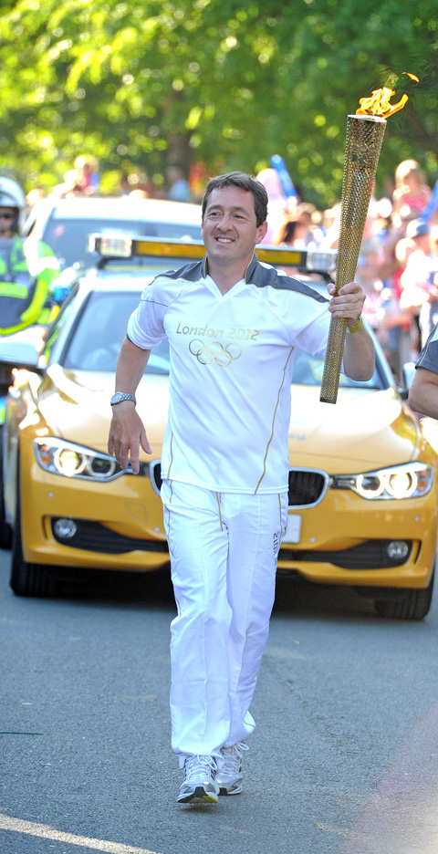Chris Boardman, carrying the Olympic Torch