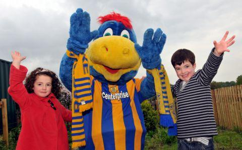 Stokey the mascot with Skye Van Hoven, four, and Christian Van Hoven, five